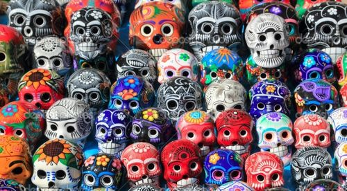 Depositphotos_5282877-Mexican-skulls-colorful-ceramic-Day-of-the-Dead