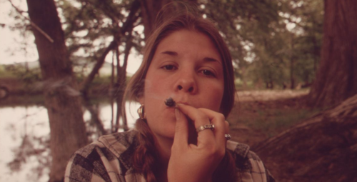 TEENAGE_GIRL_SMOKING_POT_IN_CEDAR_WOODS_WHILE_ON_AN_OUTING_WITH_FRIENDS_NEAR_LEAKEY,_TEXAS._(TAKEN_WITH_PERMISSION)..._-_NARA_-_554905