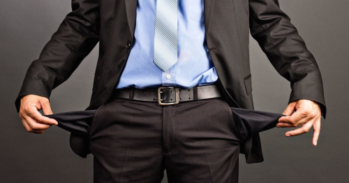 Business-man-showing-his-empty-pockets-e1438115195423