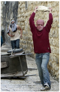 Palestinians throwing rocks