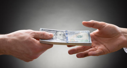 Two-people-hands-money-close-up-person-hand-giving-to-other-hand-54963615