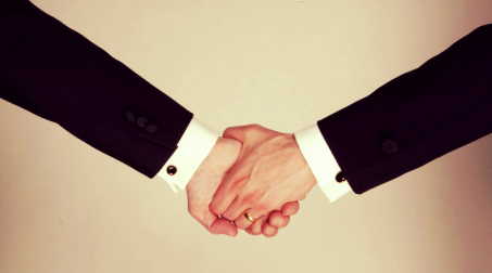 Ted-thai-arms-of-male-couple-wearing-tuxedos-holding-hands-one-with-wedding-band-illustrating-gay-marriage1