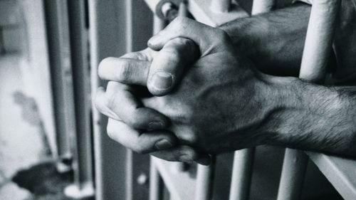 121121060253-jail-bars-hands-adhd-story-top