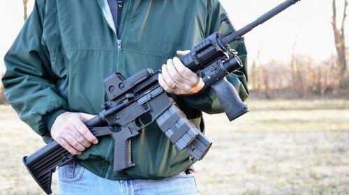 Man-holding-assault-rifle